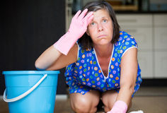 Woman scrubbing the floor Royalty Free Stock Images