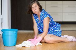 Woman scrubbing the floor Royalty Free Stock Photo