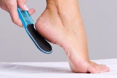 Woman scrubbing  heel Royalty Free Stock Photography