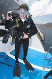 Woman scuba diver on coral reef Stock Photo