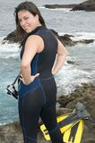 Woman scuba diver near the sea. With pins Stock Photography