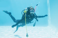 Woman on scuba training submerged in swimming pool Stock Image
