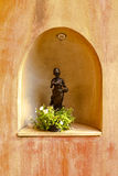 Woman sculpture on wall Stock Images