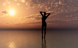 Woman and the sea. Young woman expecting the sunset Royalty Free Stock Photo