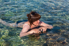 Woman in the sea Stock Images