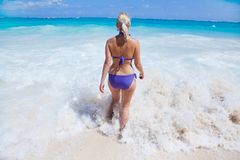 Woman in the sea. Young woman walking into the sea Royalty Free Stock Images