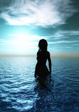Woman in the sea. 3d image with woman silhouette and reflective water Royalty Free Stock Photography