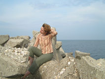 Woman at the sea. Woman dreaming at the edge of the sea Stock Images