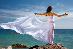 Woman and sea beach. Beautiful woman in white dress at the sea beach Royalty Free Stock Photos
