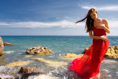 Woman and sea beach. Beautiful woman in red dress at the sea beach Royalty Free Stock Images