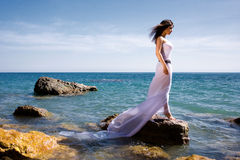 Woman and sea beach. Beautiful woman in white dress at the sea beach Stock Photography