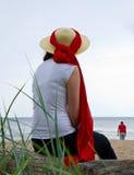 Woman on sea beach Stock Image