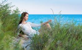 Woman in the sea beach Stock Image
