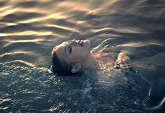 Woman in the sea Stock Photo