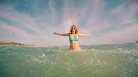 Woman in the sea. Woman enjoying her vacation in the sea stock video footage