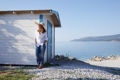Woman by the sea Stock Images