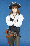 Woman - sea pirate on blue background with pistol Stock Photos