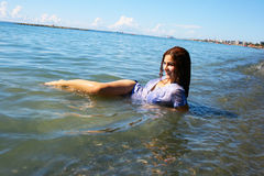 Woman in sea stock photo