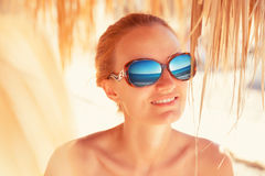 Woman with sea reflection in sunglasses Stock Photo