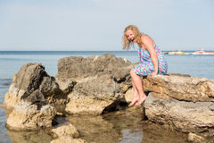 Woman on sea rocks royalty free stock images