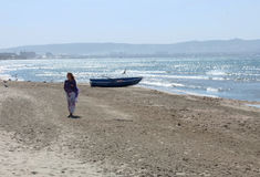 Woman on the sea shore Stock Images