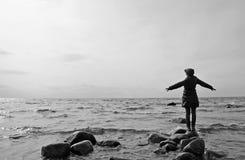 Woman at the sea shore Stock Photo