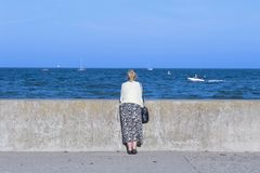 Woman at the sea side stock photo