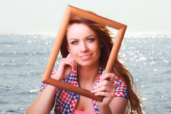 Woman Holding Frame travel concept Royalty Free Stock Photography