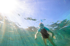 Woman sea snorkeling. Young female snorkeling in tropical blue sea Royalty Free Stock Images
