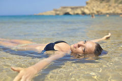 Woman in the sea. In the summer Stock Photo