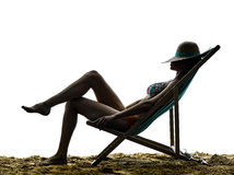 Woman sea sunbathing holidays vacations on the beach Stock Images