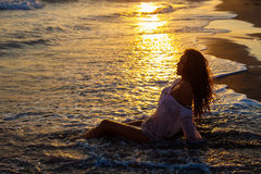 Woman sea and sunset Royalty Free Stock Images
