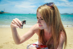 Woman With Sea Turtle Royalty Free Stock Photos
