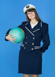 Woman in sea uniform with globe Royalty Free Stock Photos