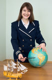 Woman in a sea uniform with the globe Stock Photos