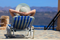 Woman on sea vacation by the pool Stock Image