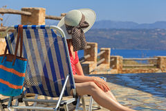 Woman on sea vacation by the pool Royalty Free Stock Photos