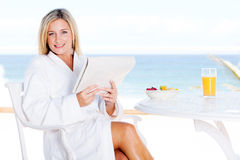 Woman sea view breakfast Stock Image