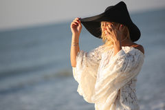 Woman by the sea Stock Photography