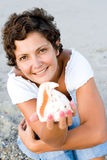 Woman on seacoast with a cockleshell in hands Stock Images