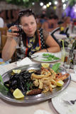 Woman in seafood restaurant Royalty Free Stock Photo