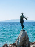 Woman with seagull, Opatija, Croatia Royalty Free Stock Photography