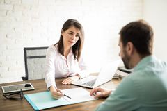 Woman sealing a deal with client Royalty Free Stock Photo