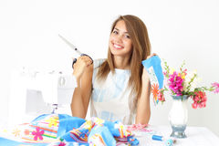 Woman Seamstress And Sewing Machine Stock Image