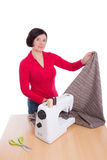 Woman seamstress demonstrates textile. Stock Images