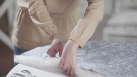 Woman seamstress pulls the safety pin of the needle bed. stock footage