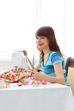 Woman seamstress and sewing machine Stock Images