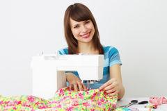 Woman seamstress and sewing machine Royalty Free Stock Images