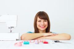 Woman seamstress and sewing machine Stock Photo
