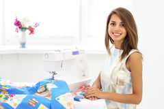 Woman seamstress and sewing machine Royalty Free Stock Photo